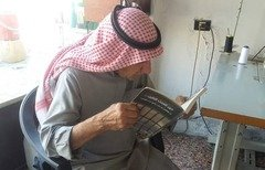 "An elderly man reads ""When prisons speak"", a new book by Syrian author Ghada Bakir, which tells the stories of detainees who died under torture in Syrian regime prisons. [Photo courtesy of Ghada Bakir]"