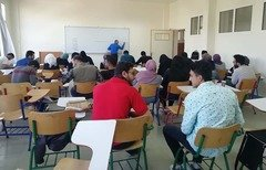 Syrian refugee students in Lebanon attend a university class. Many have obtained scholarships from Lebanese universities and international donors to complete their education. [Photo courtesy of the University Students Forum in Lebanon]