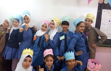 Students in Jordan's Maan governorate receive new backpacks