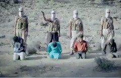 A screenshot from a video widely circulated online shows four masked ISIS gunmen moments before they executed four youths at an undisclosed location in Yemen's al-Bayda province.