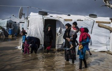 Two snowstorms have battered Lebanon in less than two weeks, wreaking havoc in the informal refugee camps scattered throughout the country. [Photo courtesy of UNHCR]