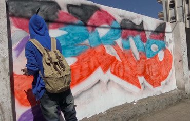 رسوم جدارية تعكس الأمل والخوف في اليمن الذي تعصف به الحرب