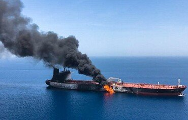 2 tankers catch fire after suspected Gulf of Oman attacks