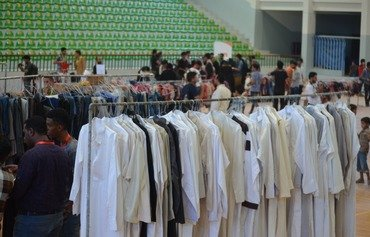 Yemeni civil society, youth initiatives provide Eid clothes for the poor