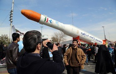 US accuses Iran of building missiles through satellite bid